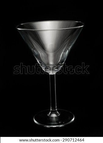 Empty Martini Glass isolated on black