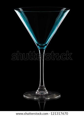 Empty martini glass. Isolated on black background - stock photo