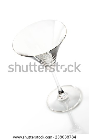 Empty martini glass on a white background - stock photo
