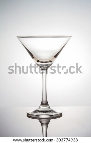 Empty martini glass with clipping path on white background - stock photo