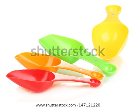 Empty measuring cups for washing powder isolated on white - stock photo