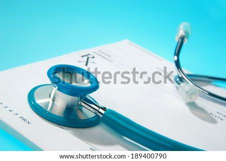 Empty medical prescription on blue, reflective background - stock photo