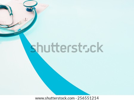 Empty medical prescription with a stethoscope on blue reflective background - stock photo