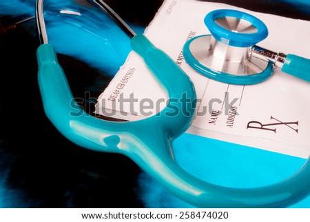 Empty medical prescription with a stethoscope on Xray photo of lungs - stock photo