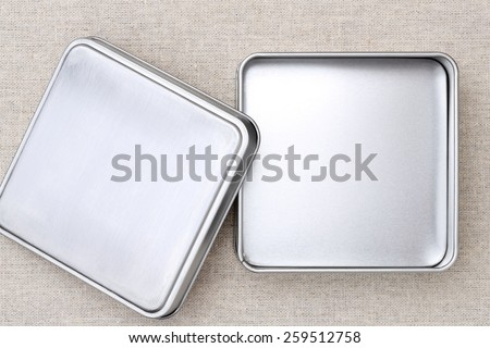 Empty metal box on burlap background - stock photo