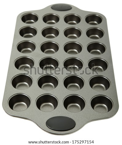 Empty Metal Muffin Tray over White - stock photo