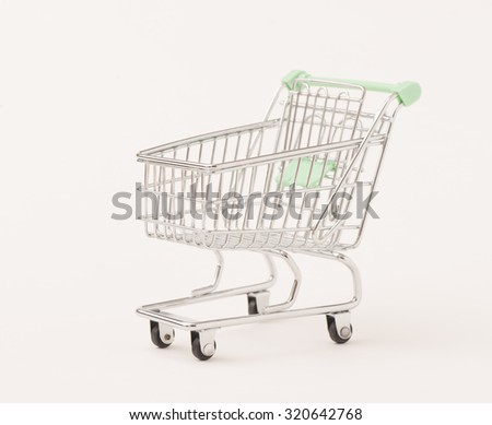 Empty metal shopping cart on white background. Conceptual image of retail store, sale and commerce.