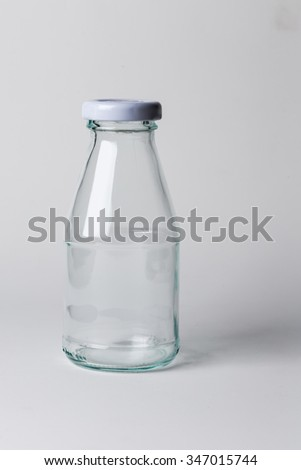 Empty milk glass bottle, isolated.