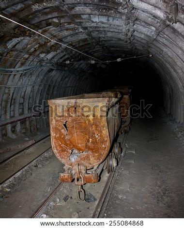 Empty mine trolley in mines - stock photo