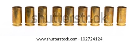 Empty 9mm bullet casings over white background - stock photo