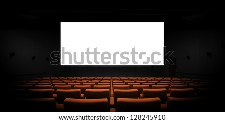 Empty modern cinema with blank white screen - stock photo