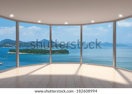 Empty modern lounge area with large bay window and view of sea - stock photo