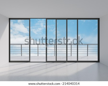 Empty modern lounge area with large window and view of sky with clouds - stock photo