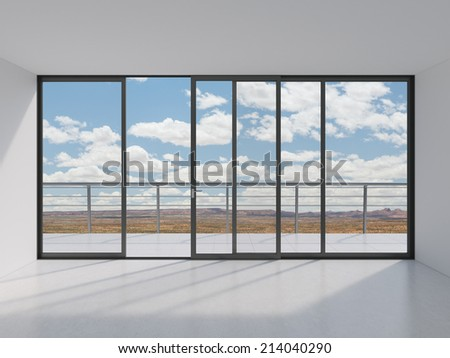 Empty modern lounge area with large windows and view of sea - stock photo