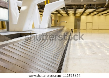 empty modern luggage band in the airport - stock photo