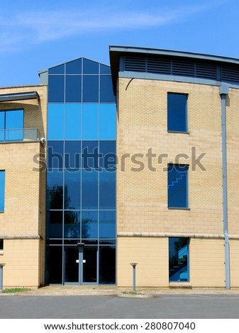 Empty modern office building on a business park. - stock photo