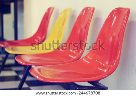 empty modern row chairs with retro instagram filter (shallow depth of field) - stock photo