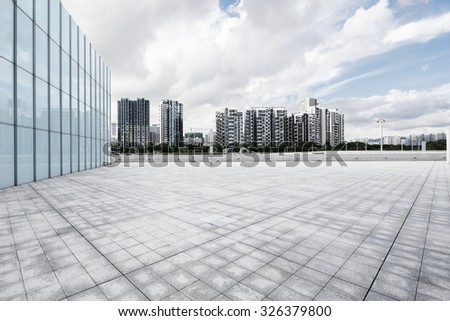 empty, modern square and skyscrapers in modern city - stock photo