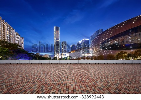 empty, modern square and skyscrapers in modern city at night
