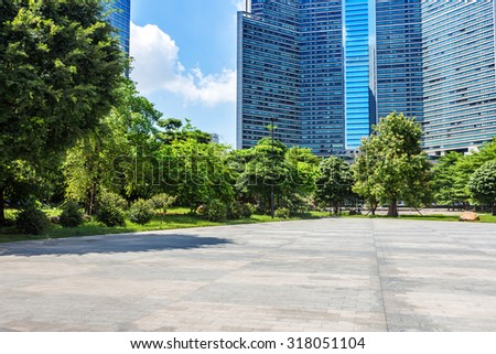 empty, modern square and skyscrapers under sunbeam - stock photo