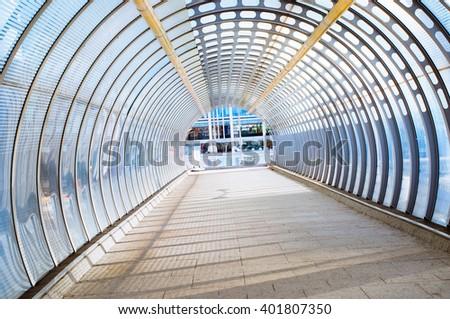 Empty modern tunnel, United Kingdom, London, Canary Wharf area.  - stock photo