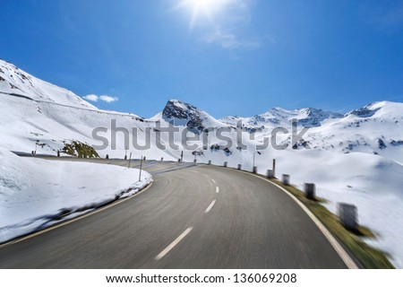 Empty mountain road with slight motion blur - stock photo
