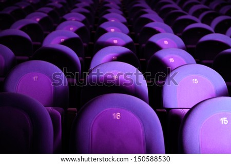Empty Movie Theater with Purple Seats - stock photo