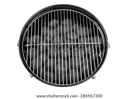 Empty New Clean BBQ Kettle Grill With Charcoal Briquettes In The Pit Isolated On White Background Overhead View - stock photo