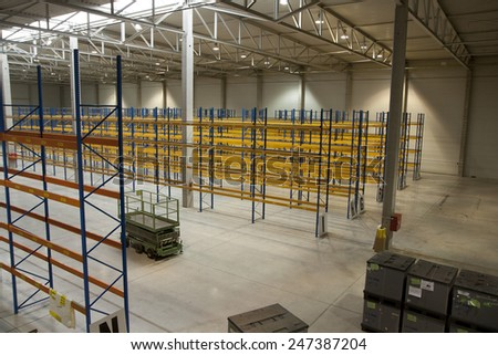 empty new warehouse prepared to start business - with racks - stock photo