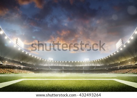 Empty night grand soccer arena in lights - stock photo