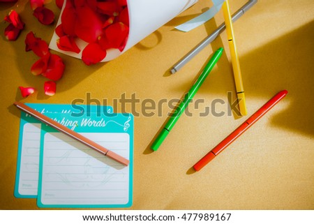 Empty note pad for writing and colorful pens with rose