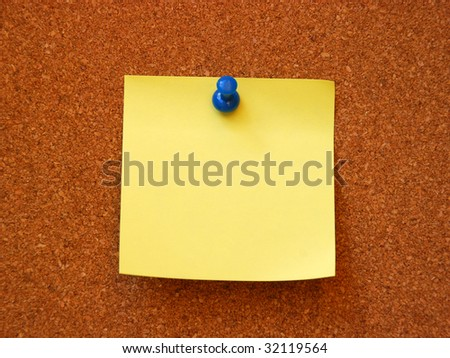 empty note pad on cork board