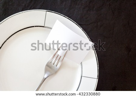 Empty note paper attached to fork - stock photo