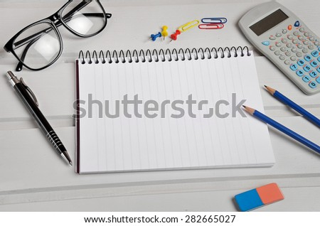 Empty notebook and office supplies