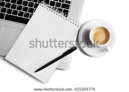 Empty  notebook on laptop keyboard, on light background