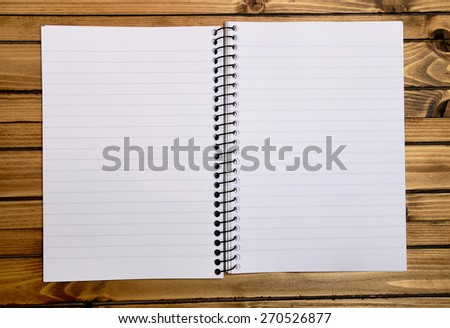 Empty notebook on wooden table