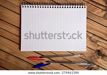 Empty notepad and pen on table