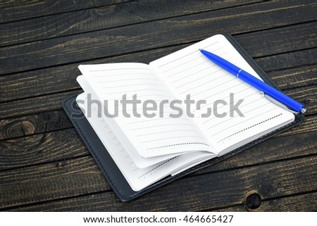 Empty notepad on wooden table