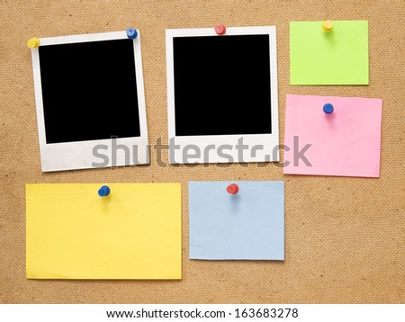 empty notes and photo frames on wooden background - stock photo