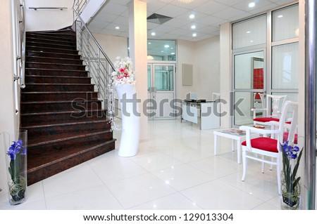 Empty nurses station in a modern hospital-foyer - stock photo