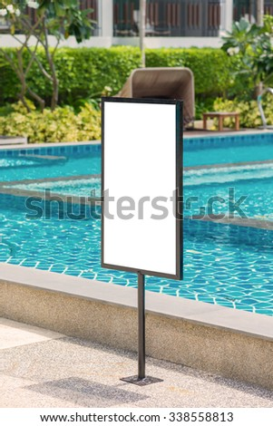 empty of sign standing near a swimming pool.
