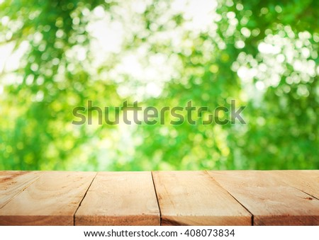 Empty of wood table top on blur of fresh green abstract background .For montage product display or design key visual layout - stock photo