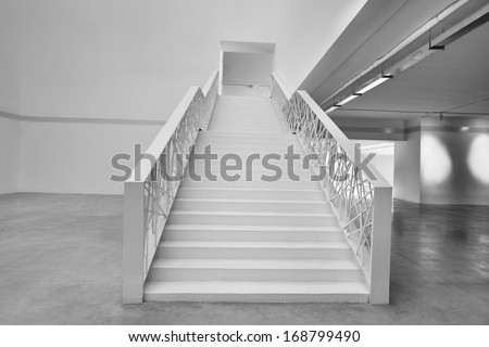 Empty office building stairway composition