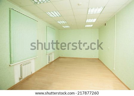 empty office space with windows - stock photo