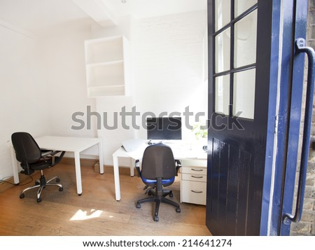 Empty office with chairs and tables
