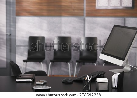 Empty office with tidy desktop, computer, personal organizer. - stock photo