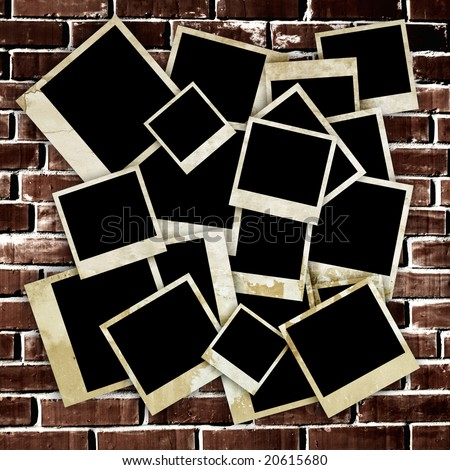 Empty old photo frames on grunge brick wall background