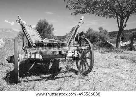 Empty old rural wooden wagon, close up black and white photo