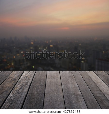 Empty old wood floor with blurred aerial view of cityscape on warm light sundown, for your product display montage