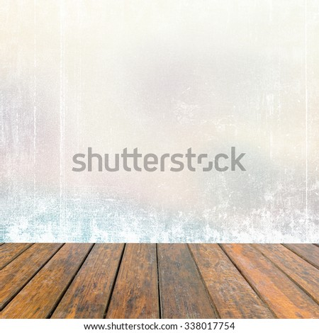 Empty old wooden deck table with abstract grunge background - stock photo